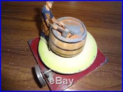 A German Doll et Cie live steam engine driven tinplate toy Cooper barrel maker