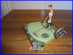 A German Doll et Cie live steam engine driven tinplate toy Gardener farmer Sythe