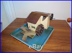 A German Marklin live steam engine driven toy model tinplate watermill pump