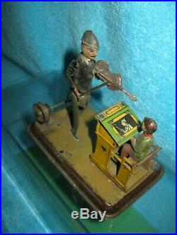 Becker Violinist & Student Tin Painted & Litho Steam engine Toy articulated