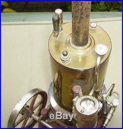 Bing German toy vertical steam engine with 2 tinplate accessories