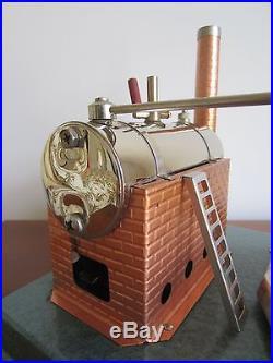 Older Model 75 stationary live steam engine model from Jensen Mfg