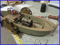 Steam Engine With Side Paddle's On Wooden Boat
