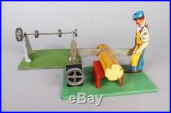 Vintage man with saw & transmision, steam engine accessory, german tin toy